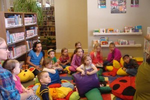 kids gathered for a story on the floor