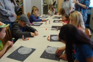 kids in library doing crafts about the moon