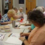 Group of ladies coloring.