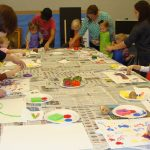 Children and parents painting with vegetable stamps