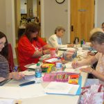 Group of ladies coloring.