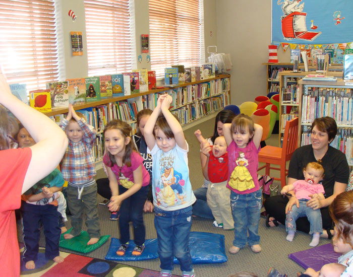 Children and parents pretending to be rocket ships.