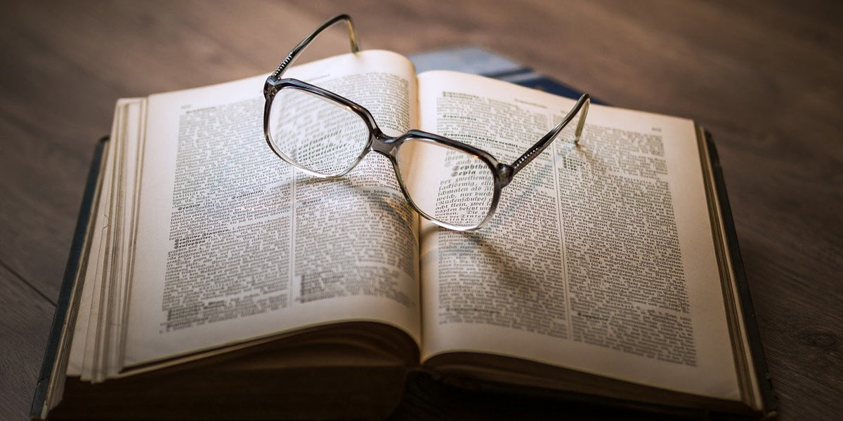 Book and reading glasses.